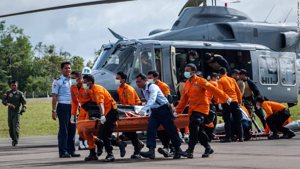Members of a search and rescue team carry the body of a victim in Pangkalan Bun on Thursday, January 1.