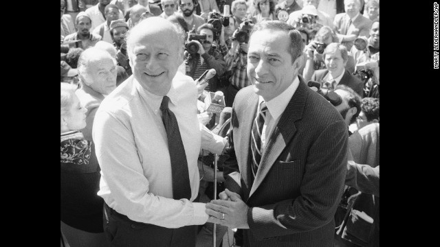 New York Mayor Ed Koch shakes hands with Cuomo on the steps of City Hall in New York on Monday, Oct. 7, 1985.   Cuomo announced his endorsment of Koch for mayor.