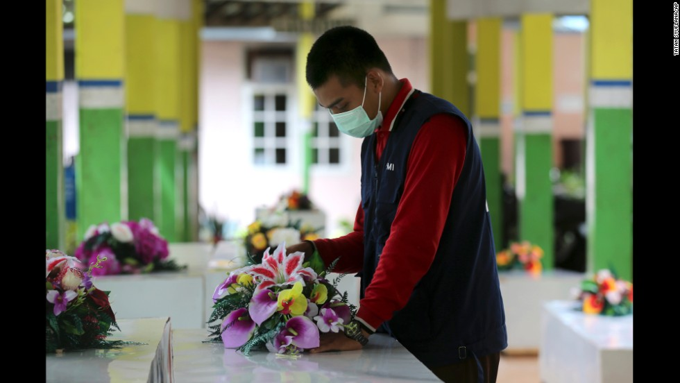 A member of the Indonesian Red Cross prepares coffins at a hospital in Pangkalan Bun on January 2.