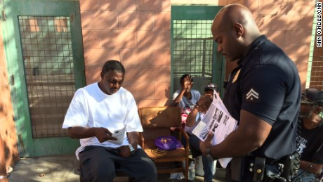 Joseph used to make more arrests: now he also hands out hygeine kits and housing information.