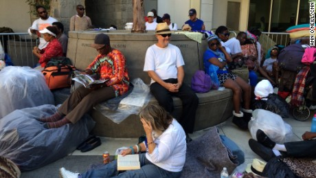 Long before the sun sets, people start lining up outside Skid Row's missions.