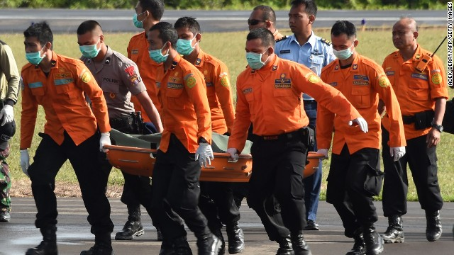 Members of an Indonesian search and rescue team carry the body of a victim recovered in the search for wreckage of AirAsia flight QZ8501, lost over the Java Sea, in Pangkalan Bun, the town with the nearest airstrip to the crash site, in Central Kalimantan on January 2, 2015.