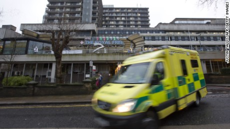 Caption:An ambulance pulls away from The Royal Free hospital in north London on Janurary 3, 2015, where it was announced that British nurse Pauline Cafferkey, who contracted Ebola while working in Sierra Leone, is in 'critical condition'. AFP PHOTO / JUSTIN TALLIS (Photo credit should read JUSTIN TALLIS/AFP/Getty Images)
