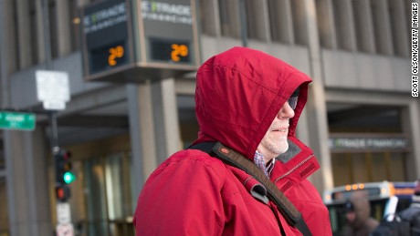 Caption:CHICAGO, IL - JANUARY 05: A commuter makes his way to work as temperatures hovered around zero degrees Fahrenheit during the morning rush on January 5, 2015 in Chicago, Illinois. Temperatures are expected to remain in the single digits today and three to six inches of snow are expected to fall this evening. (Photo by Scott Olson/Getty Images)