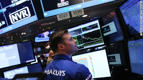 Traders work on the floor of the New York Stock Exchange (NYSE) on January 6, 2015 in New York City. Stocks were up slightly in morning trading following a steep decline yesterday partly on fears of a continued fall in global oil prices.