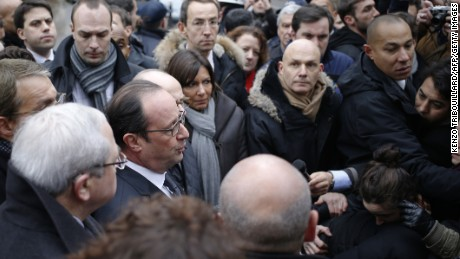 French President Francois Hollande speaks to the press after arriving at the scene of the shooting.