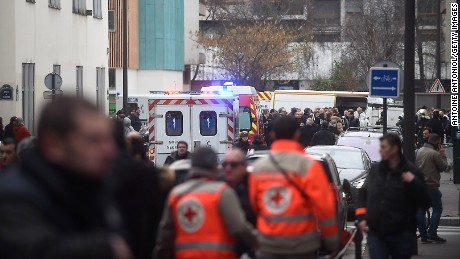 PARIS, FRANCE - JANUARY 07: Ambulances and police officers gather in front of the offices of the French satirical newspaper Charlie Hebdo on January 7, 2015 in Paris, France. Armed gunmen stormed the offices leaving eleven dead, including two police officers, according to French officials. (Photo by Antoine Antoniol/Getty Images)