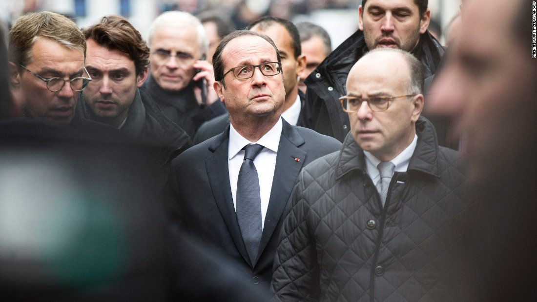 French President Francois Hollande, center, and Cazeneuve, right, arrive at the scene of the shooting.