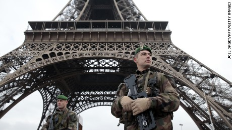 French soldiers patrol around the Eiffel Tower on January 7.