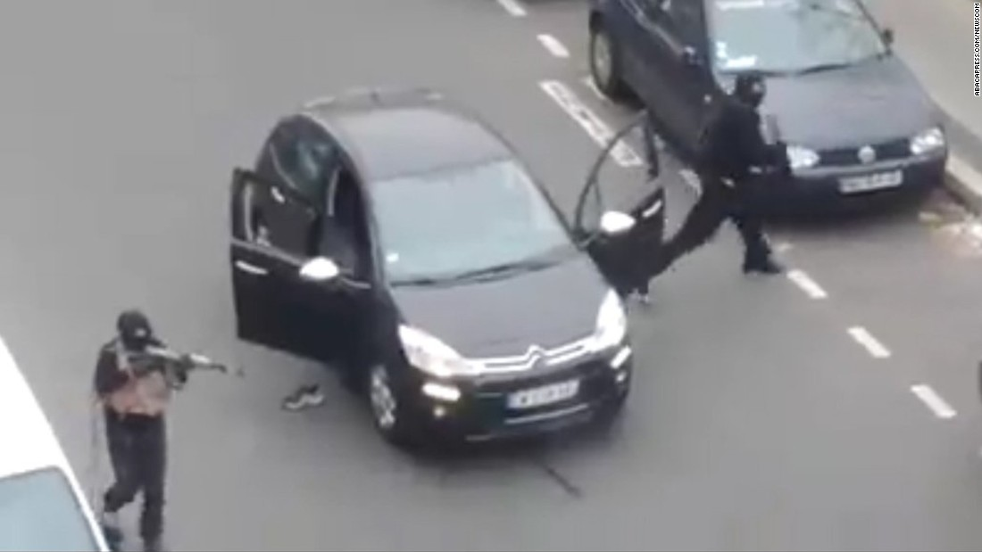 Gunmen step out of a car to shoot and kill a police officer near the Charlie Hebdo office on January 7.