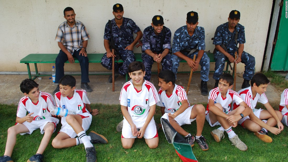 Wearing their Palestinian kit, children from Gaza get ready for football practice.