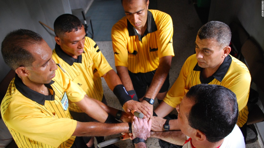 Referees In Gaza are pictured preparing for a match.