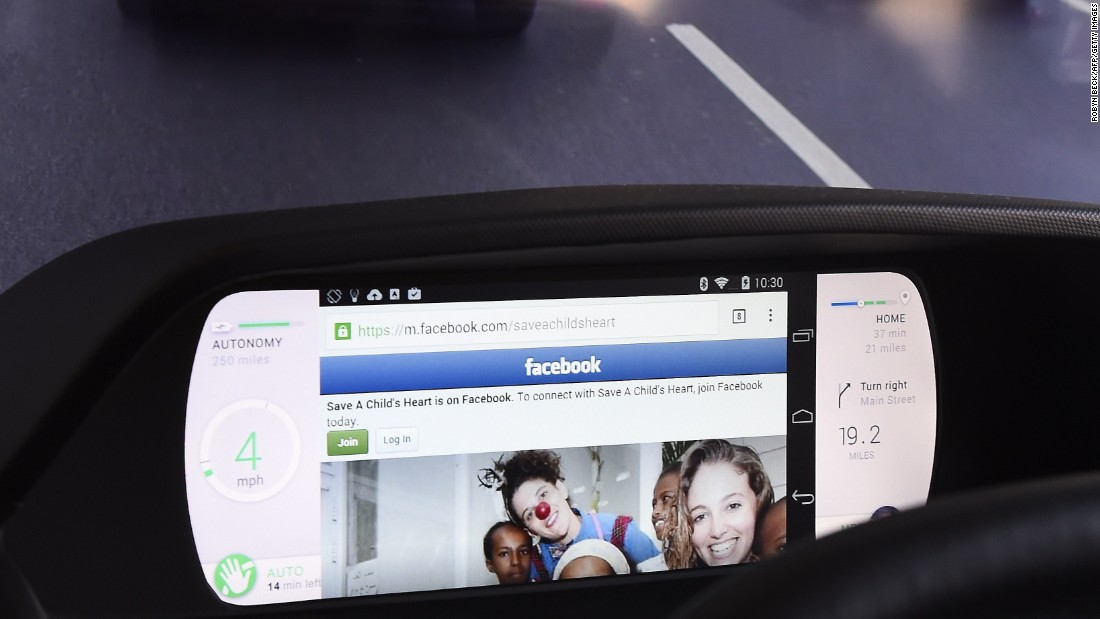 From CES, this mockup of a car dashboard shows Facebook on a wirelessly connected smartphone displayed on a Mobi/us autonomous dashboard -- a concept for interacting with a self-driving car as well as with a smartphone. When the car is driving on autopilot mode the driver can watch movies or surf the web on their wirelessly connected smartphone.