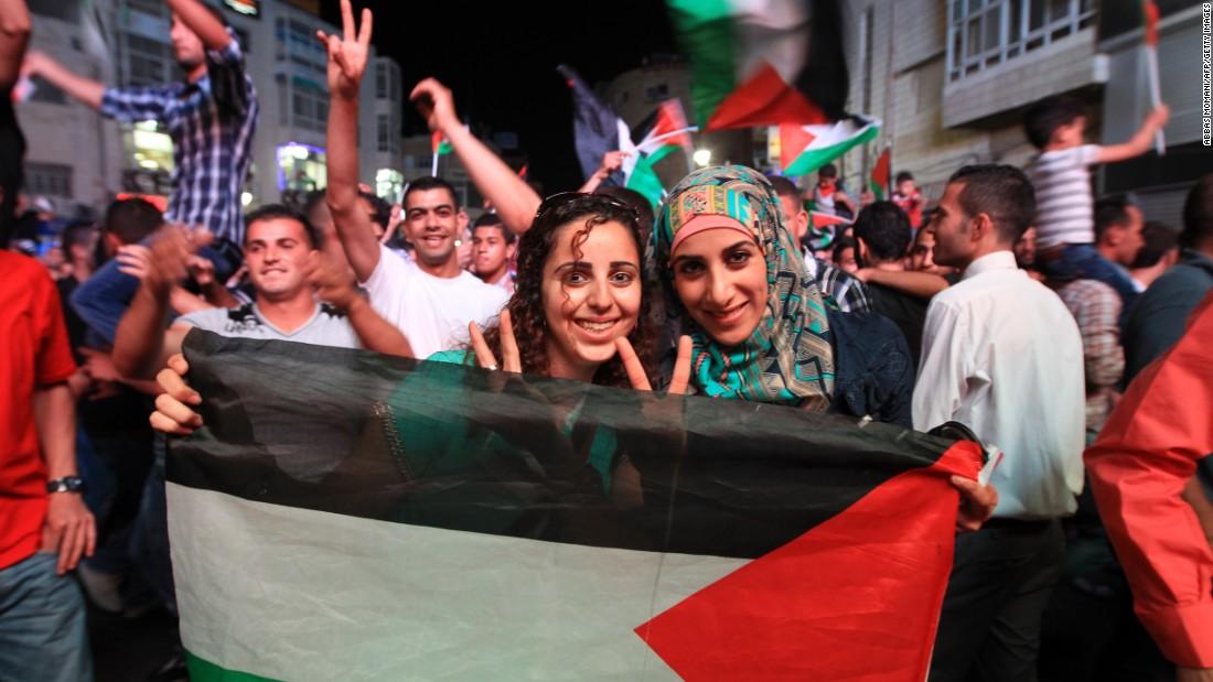 Hundreds of fans pour onto the street to celebrate the Palestinians' historic success. The Asian Cup will be the first time they have competed in a major international tournament. The Palestinians will make their debut against defending champion Japan in Newcastle, Australia, on Monday.