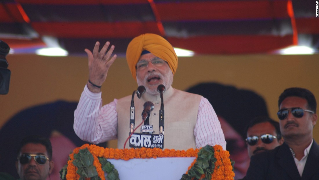Modi speaks at a rally in Punjab wearing a saffron turban, also known as Dastar. A piece of long cloth is tied and wound around the head several times and is worn by Sikhs across the world.