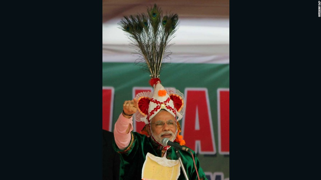 Seen here is another Manipuri headgear with peacock feathers usually worn by dancers who play the part of Lord Krishna, a Hindu God, in a traditional Manipuri dance. Modi wears it in Imphal, the state capital, during an election rally.