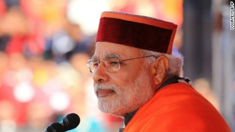 Narendra Modi wearing a traditional Maroon Pahari topi -- mountain cap that is often given to guests visiting the state of Himachal Pradesh in India. These hats are famous art work of the local tribes in the state. They come in two colours, green and maroon and with different designs representing different areas in the state.