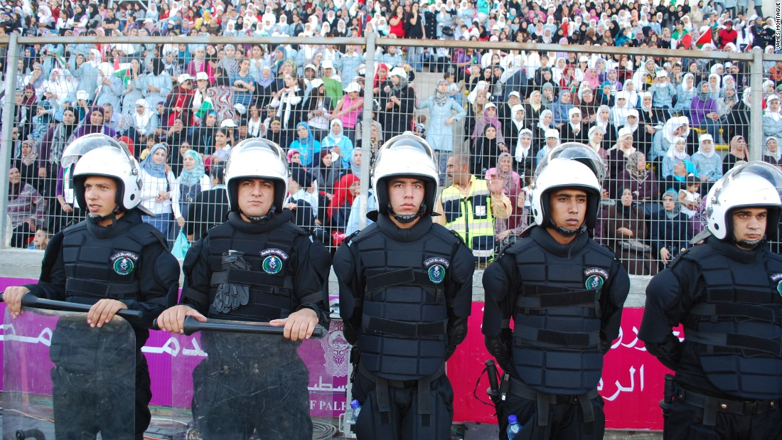 "Palestinian policemen guard a stand full of female spectators at the first women's home match in 2009. <a href=""http://edition.cnn.com/2009/SPORT/football/11/06/palestinian.womens.football.westbank/"" target=""_blank"">Read: Women flock to see first female football game in West Bank</a>"