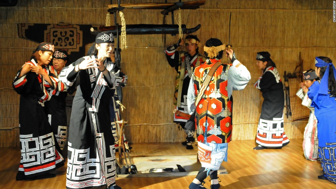 On the shores of Hokkaido's Lake Poroto, the recreated Ainu village hosts regular folk dance displays.
