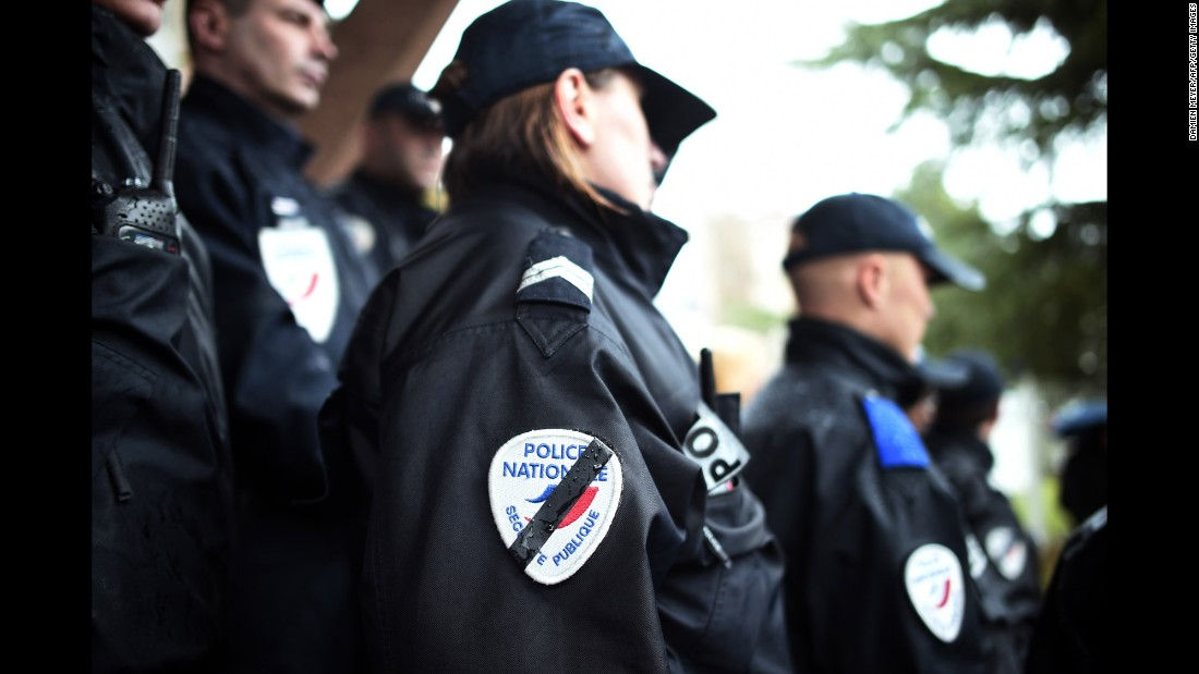 Police observe a moment of silence January 8 in Rennes, France.