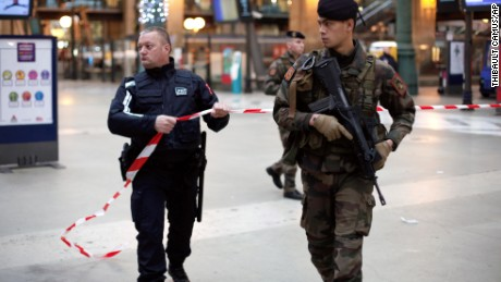 French soldiers patrols at the Gare du Nord railway station, in Paris, France, Thursday, Jan. 8, 2015. Scattered gunfire and explosions shook France on Thursday as its frightened yet defiant citizens held a day of mourning for 12 people slain at a Paris newspaper. French police hunted down the two heavily armed brothers suspected in the massacre to make sure they don't strike again. (AP Photo/Thibault Camus)