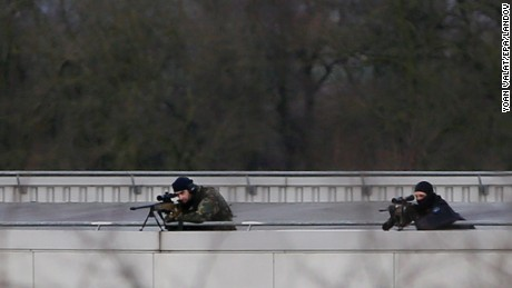 Snipers stand on the top of an opposite building to the CTD printing building in an industrial area where the suspects in the shooting attack at the satirical French magazine Charlie Hebdo headquarters are reportedly holding a hostage, in Dammartin-en-Goele, some 40 kilometres north-east of Paris, France, 09 January 2015.