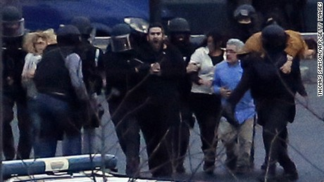 French police special forces help  hostages after launching an assault at a kosher grocery store.