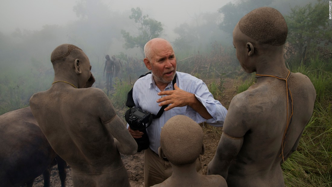 Steve McCurry with members of the Surma Tribe.