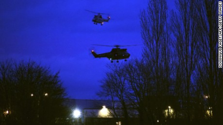 Helicopters fly over buildings in Dammartin-en-Goele, France, where there was a standoff Friday, January 9, between police and two men suspected in the Charlie Hebdo shootings earlier this week. Cherif and Said Kouachi, the two brothers wanted in the case, were killed by security forces, a local mayor said.