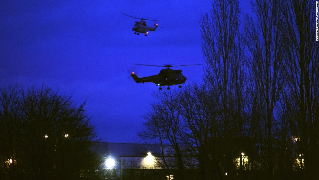 "Helicopters fly over a printing shop in Dammartin-en-Goele, France, where there was a standoff Friday, January 9, between police and two men suspected in <a href=""http://www.cnn.com/2015/01/07/world/gallery/paris-charlie-hebdo-shooting/index.html"" target=""_blank"">the Charlie Hebdo shootings</a> earlier this week. Cherif and Said Kouachi, the two brothers wanted in the case, were killed by security forces, authorities said."