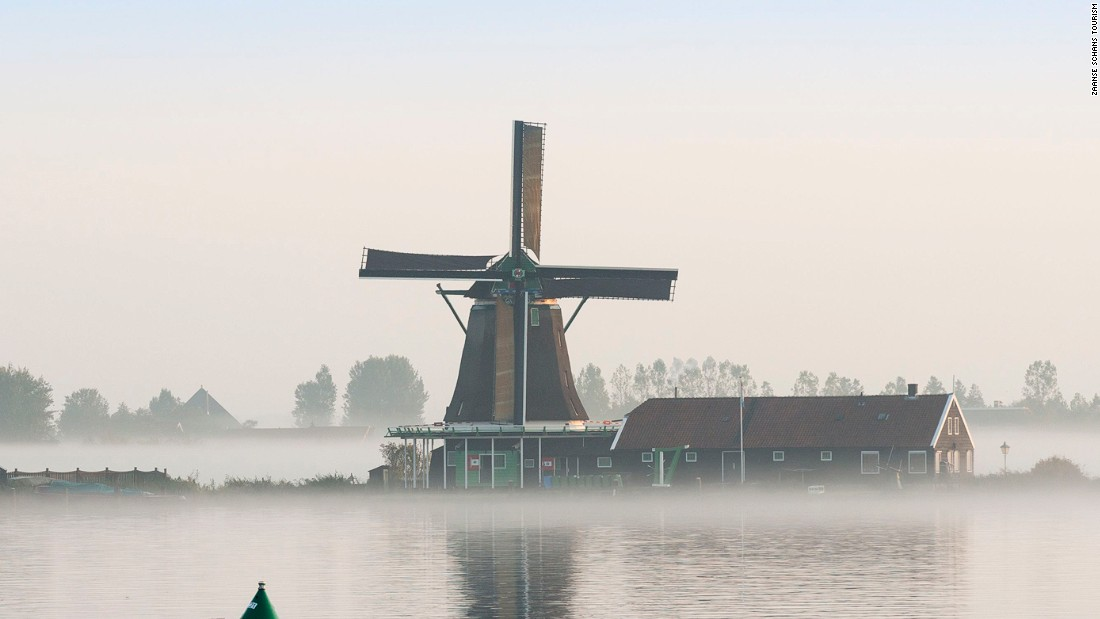 Dawn breaks over Zaanse Schans, the Netherlands, one of the few places in the world where you can still find traditional working windmills