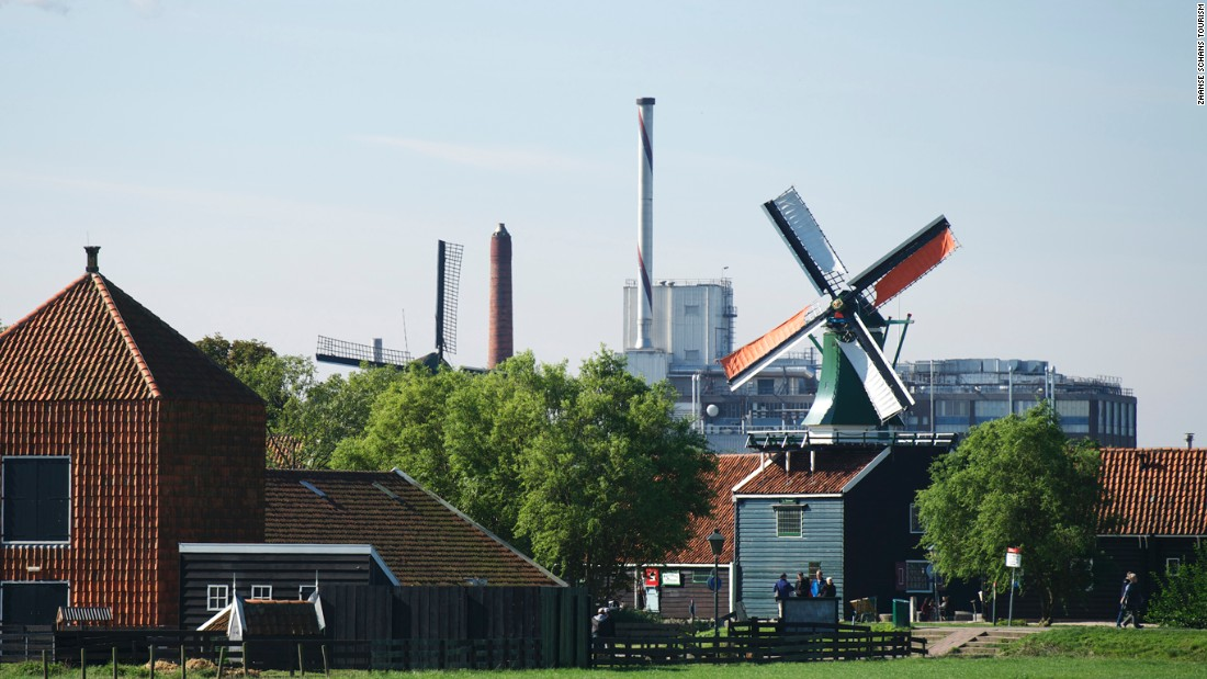 The Zaanse Schans windmills have resisted modernity, however close it may loom