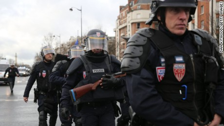 Caption:PARIS, FRANCE - JANUARY 09: Police mobilize with reports of a hostage situation at Port de Vincennes on January 9, 2015 in Paris, France. According to reports at least five people have been taken hostage in a kosher deli in the Port de Vincennes area of Paris. A huge manhunt for the two suspected gunmen in Wednesday's deadly attack on Charlie Hebdo magazine has entered its third day. (Photo by Dan Kitwood/Getty Images)
