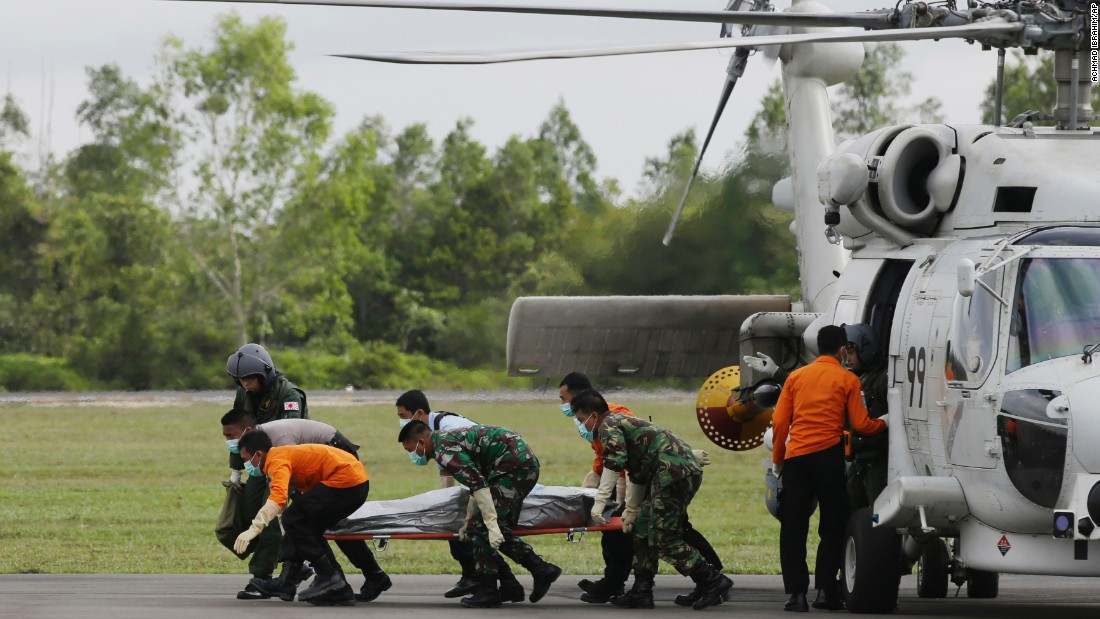 Search personnel unload the body of a victim upon arriving at the airport in Pangkalan Bun on January 9.