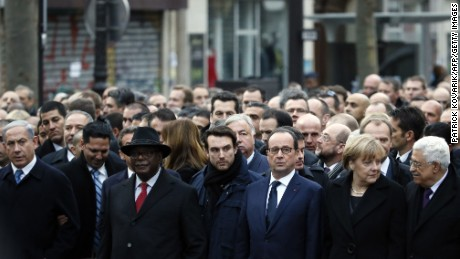 Left to right: Israeli Prime Minister Benjamin Netanyahu, Malian President Ibrahim Boubacar Keita, a bodyguard, French President Francois Hollande, German Chancellor Angela Merkel, and Palestinian president Mahmud Abbas take part in the rally.