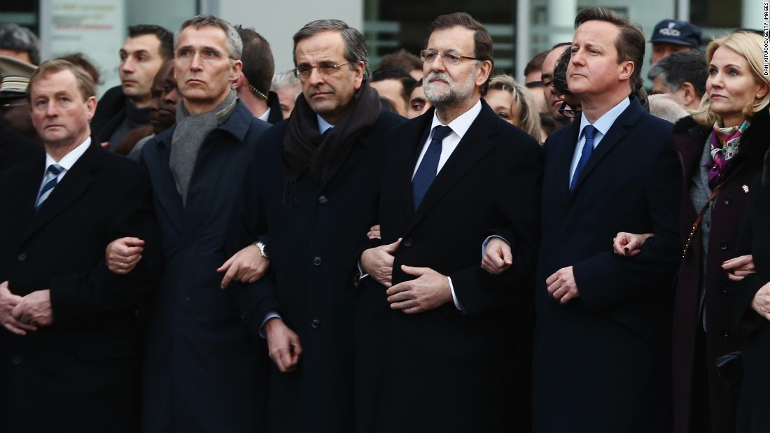 British Prime Minister David Cameron, second from right, stands with other world leaders during the rally.