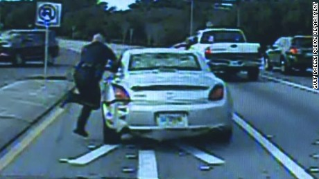 dnt fl police officer dragged by car_00005911
