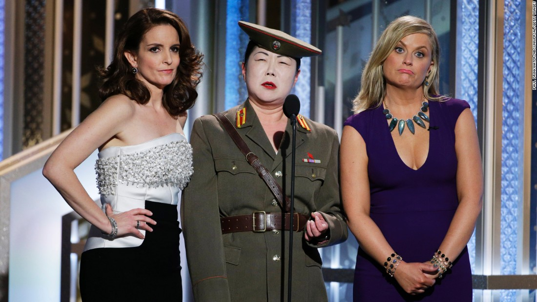 Comedian Margaret Cho, center, performs a running joke on stage with hosts Tina Fey and Amy Poehler at the Golden Globe Awards on Sunday, January 11. Cho was playing a North Korean general who was not happy with the way the awards show was progressing.