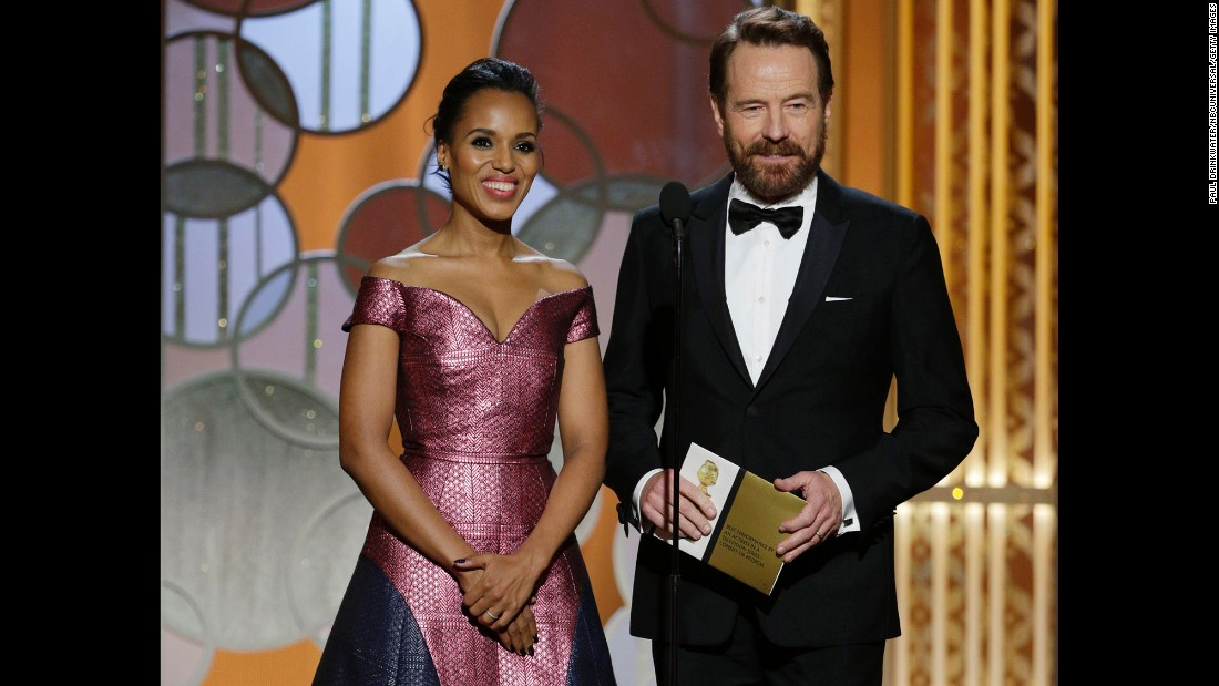 Actors Kerry Washington and Bryan Cranston take the stage to present an award.