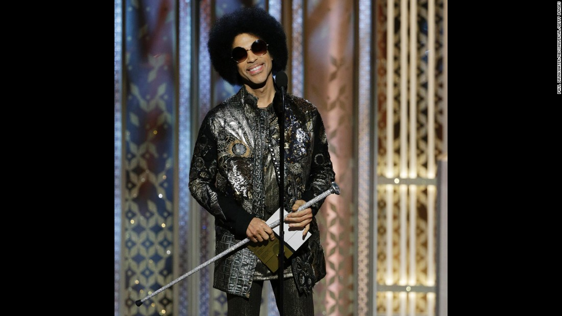 Music legend Prince surprises the crowd, showing up to present the award for best original song in a motion picture.