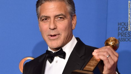 George Clooney, recipient of the Cecil B. DeMille Award, poses in the press room during the 72nd Annual Golden Globe Awards on January 11, 2015 in Beverly Hills, California.