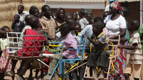 In this Thursday Nov. 27, 2014 photo, children displaced after attacks by Boko Haram, play in the camp of internal displaced people, in Yola, Nigeria.