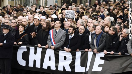 (From L) Samuel Sandler, father and grandfather of three of the victims of Islamist gunman Mohamed Merah, the Mayor of Lille and Socialist Party member Martine Aubry, Hassen Chalghoumi, Imam of the northern Paris suburb of Drancy and president of the French Association of Imams, French writer Marek Halter, UMP right-wing party member Eric Woerth and Joel Mergui, president of the Central Jewish Consistory of France and Pierre Gattaz (3rdR), head of the French employers' association (MEDEF) (5thR) take part in a Unity rally Marche Republicaine in Paris on January 11, 2015 in tribute to the 17 victims of a three-day killing spree by homegrown Islamists. The killings began on January 7 with an assault on the Charlie Hebdo satirical magazine in Paris that saw two brothers massacre 12 people including some of the country's best-known cartoonists, the killing of a policewoman and the storming of a Jewish supermarket on the eastern fringes of the capital which killed 4 local residents. AFP PHOTO / ERIC FEFERBERG (Photo credit should read ERIC FEFERBERG/AFP/Getty Images)