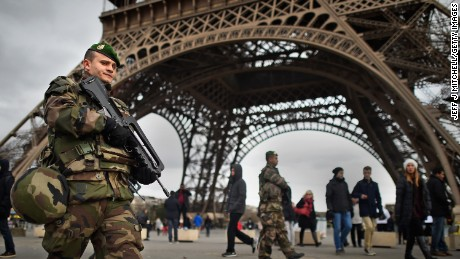 PARIS, FRANCE - JANUARY 12: French troops patrol around the Eifel Tower on January 12, 2015 in Paris, France. France is set to deploy 10,000 troops to boost security following last week's deadly attacks while also mobilizing thousands of police to patrol Jewish schools and synagogues. (Photo by Jeff J Mitchell/Getty Images)