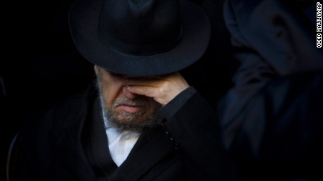 A relative of French Jew Yoav Hattab, a victim of the attack on kosher grocery store in Paris, attends his funeral procession in the city of Bnei Brak near Tel Aviv, Israel, Tuesday, Jan. 13, 2015. Israel geared up on Tuesday for the solemn funerals of four Jewish victims of a Paris terror attack on a kosher supermarket amid rising concerns over increased anti-Semitism in Europe. Hattab will be buried in Jerusalem with the other victims. (AP Photo/Oded Balilty/AP)