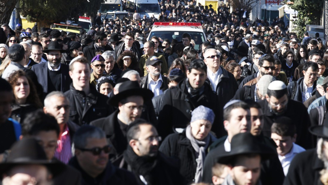 The funeral procession takes place on a Jerusalem street.