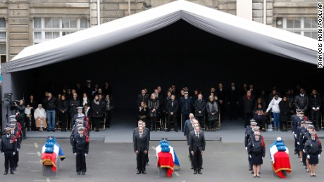 The coffins of the three police officers killed in the attacks are placed in the courtyard of the Paris Police headquarters during a ceremony to pay tribute, in Paris, France, Tuesday, Jan. 13, 2015.  (AP Photo/Francois Mori/Pool/AP)
