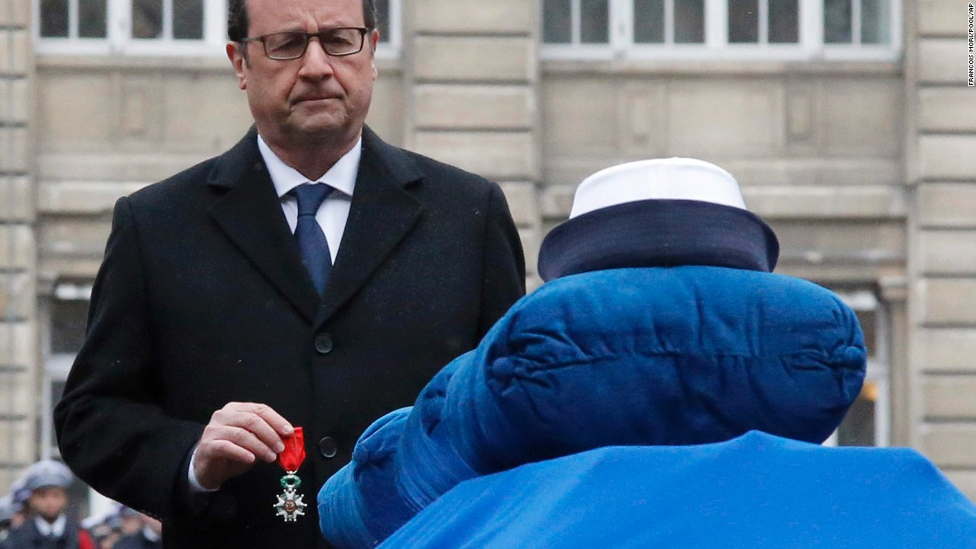 Hollande eulogized the police officers -- Merabet, Franck Brinsolaro and Clarissa Jean-Philippe -- during the ceremony on January 13. He awarded each with the Legion d'Honneur (National Order of Merit), placing a medal on each coffin.