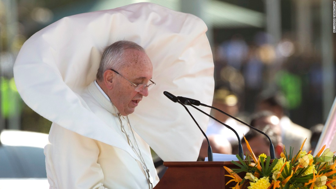 Wind blows Pope Francis' clothes as he delivers a speech at Bandaranaike International Airport near Colombo on January 13.