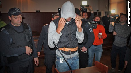 French citizen Fritz-Joly Joachin, 29, covers his face inside a Bulgarian courtroom this week.